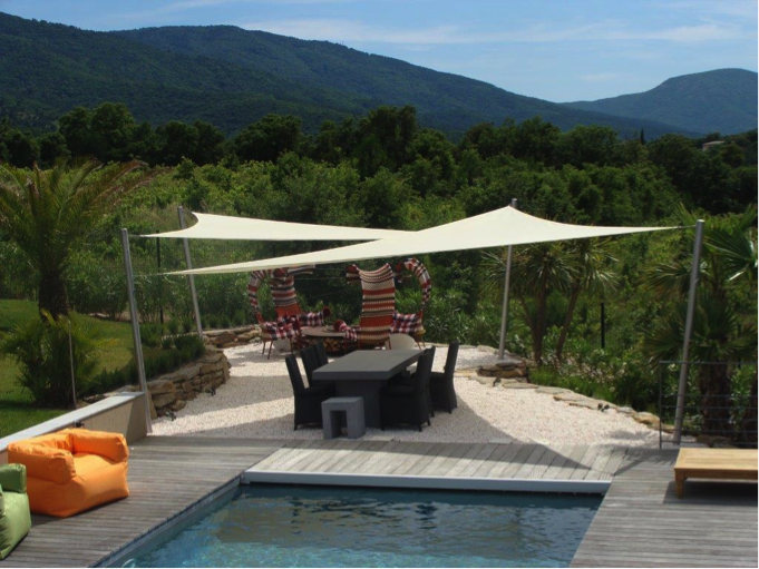 best backyard shade sails i sail shade world made in the shade i sail shade world. Black Bedroom Furniture Sets. Home Design Ideas
